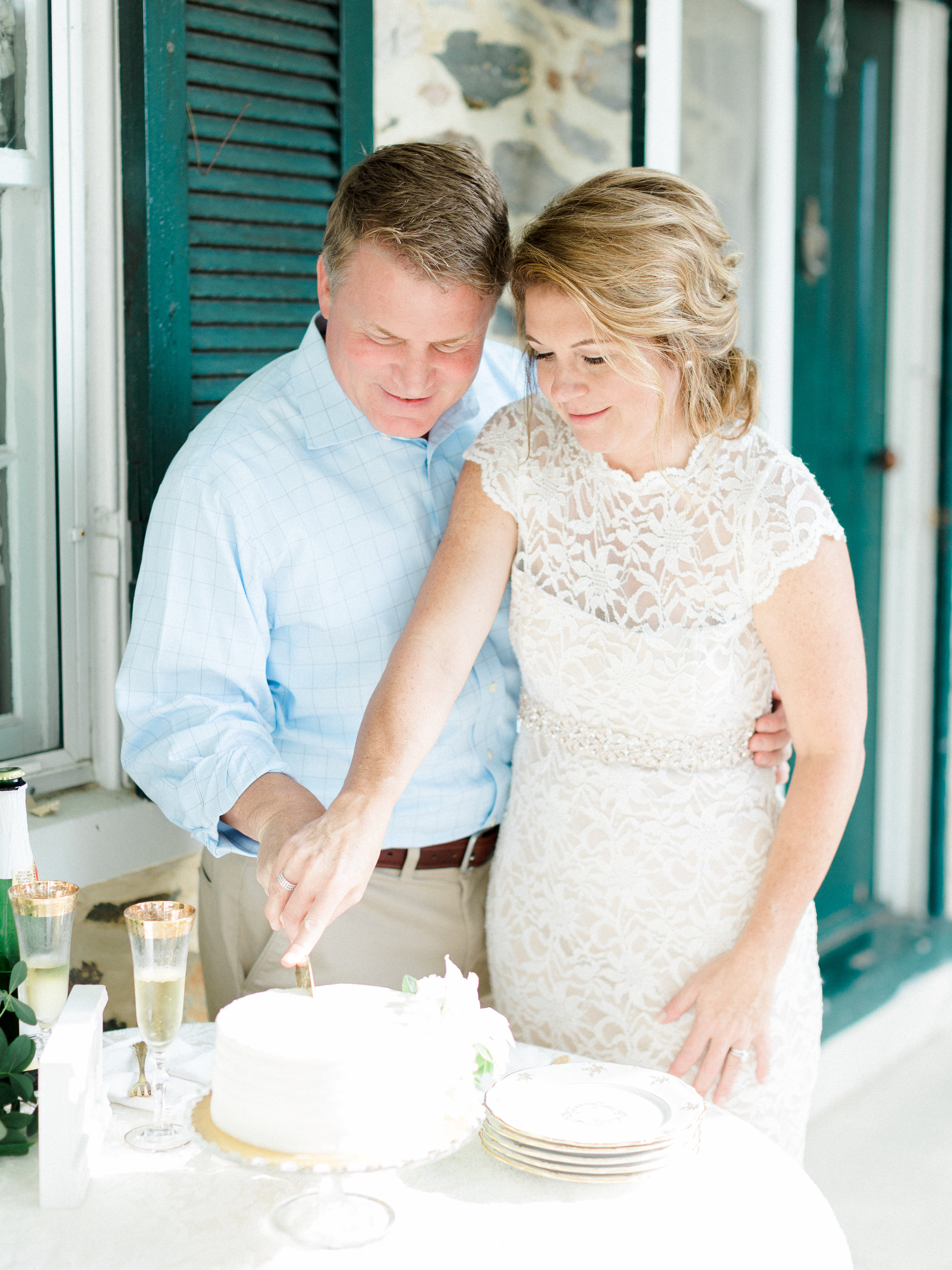 The Porch - Angie & Shaun chose to do a small cake cutting on the back porch. Such a sweet moment in the perfect place!