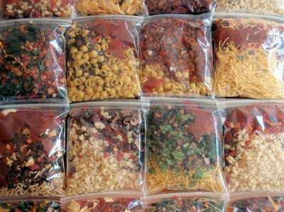 Plastic bags full of colorful dry food.