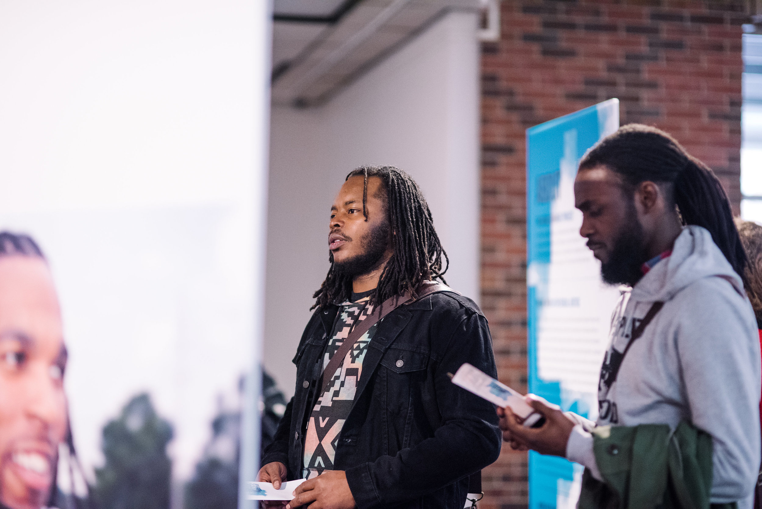 Launch of  Ferguson Voices: Disrupting the Frame  at The University of Dayton, January 2017, including image of Darren Seals (left)