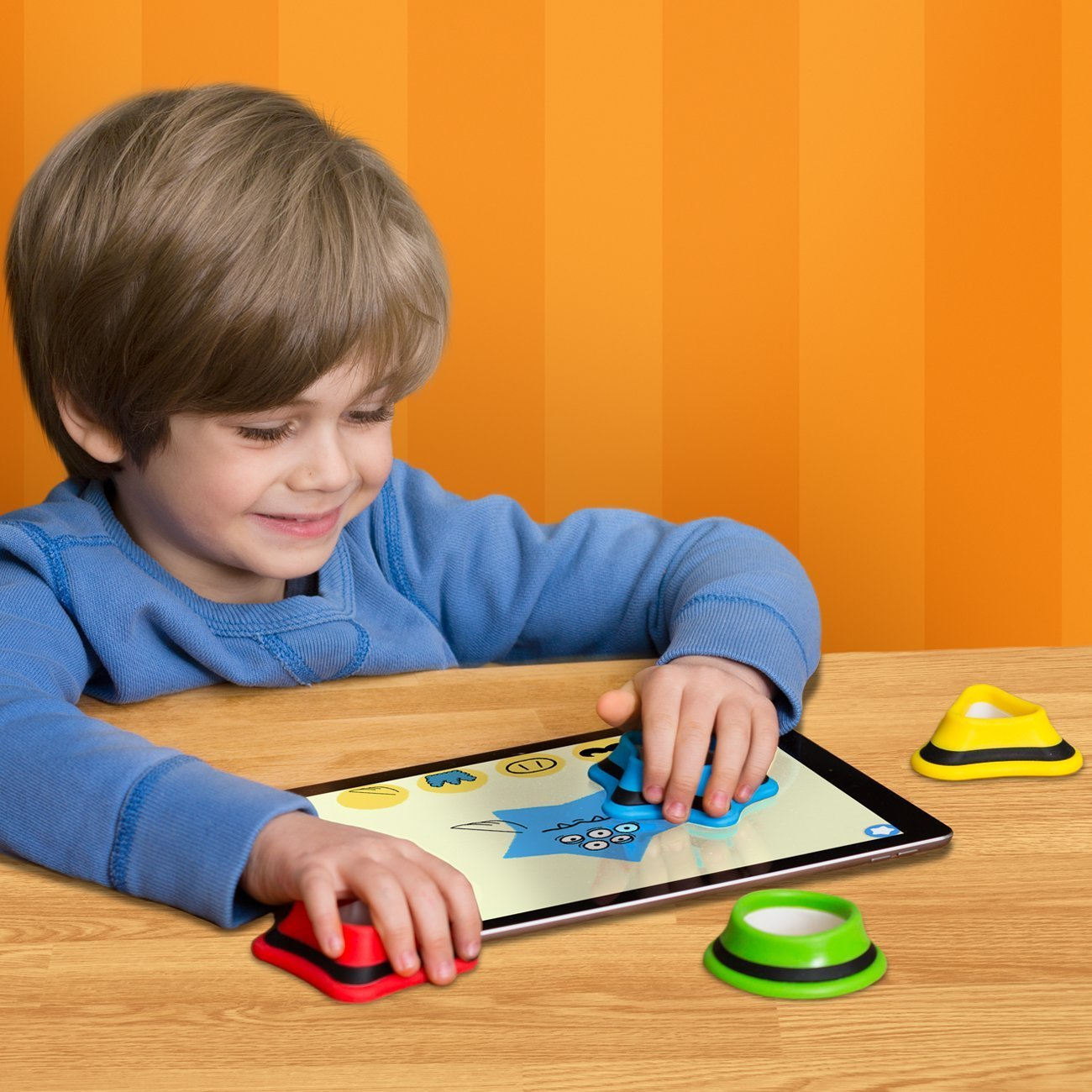 Boy playing with Kidtellect Tiggly Shapes.jpg