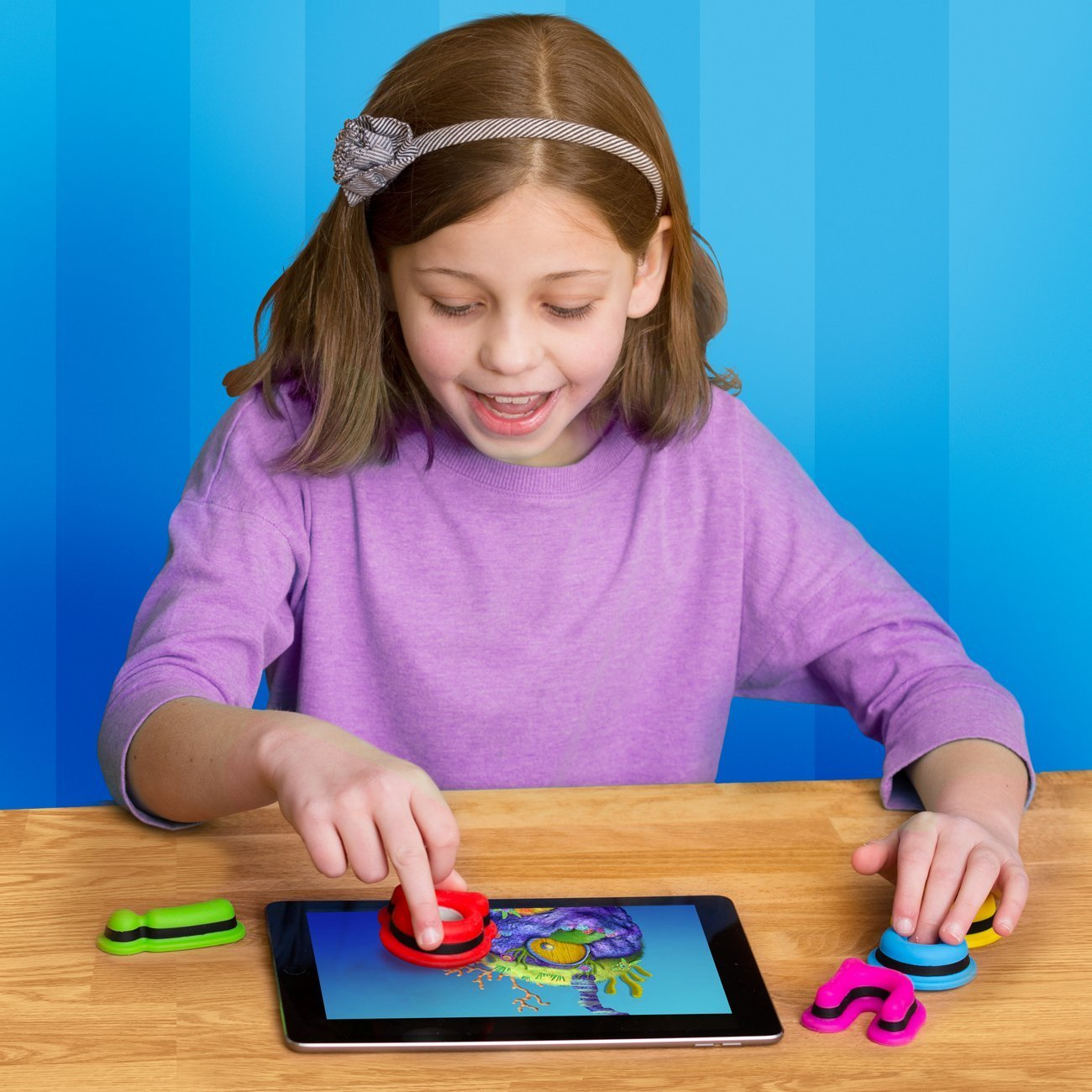 Girl playing with Kidtellect Tiggly Shapes.jpg