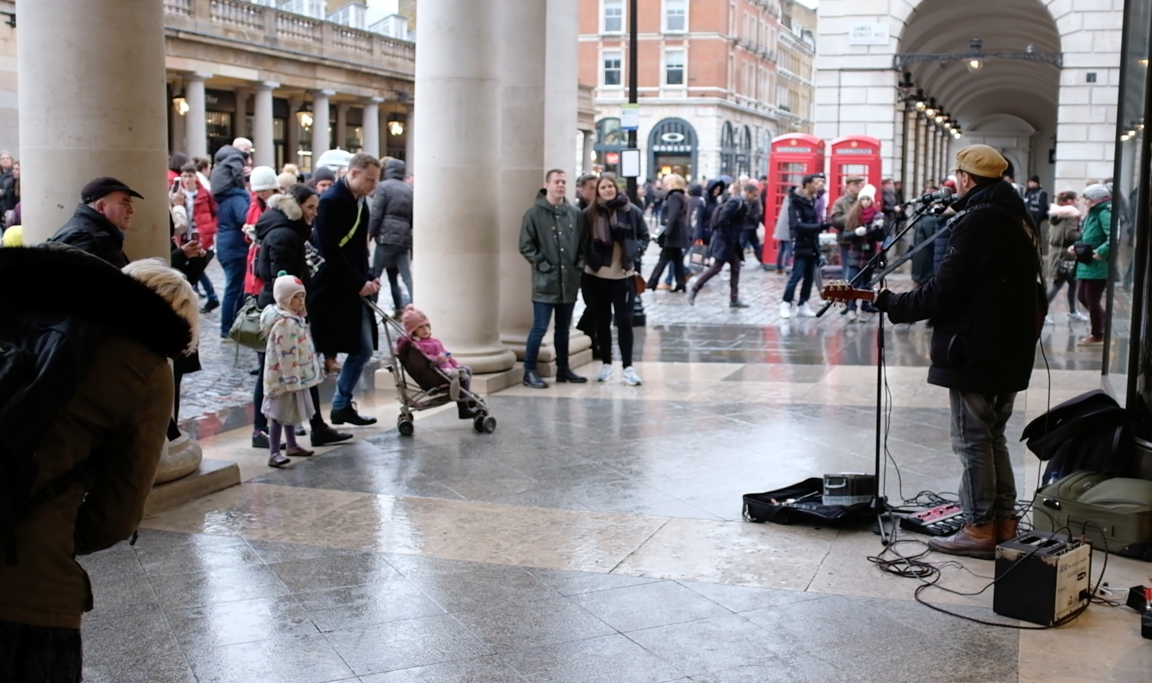 Covent Garden's private area starts right after the big columns that the audience of this performer is standing against. Any musical equipment requiring electricity is not permitted to be included in the performance inside Covent Garden.
