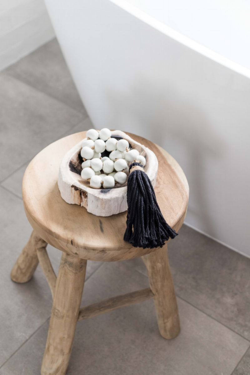 Clay beads and petrified wood bowl by Harper + Wilde. Image via the Palm Co