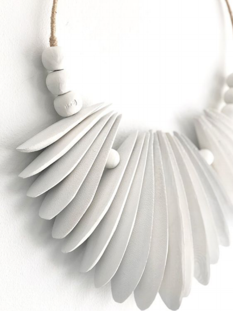 The 'Cascade' Wall Hanging, made from cuttlefish bone, clay beads and hemp. Created by 'Harper + Wilde'.
