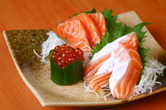 Standing Sushi Bar Salmon Sashimi .jpg