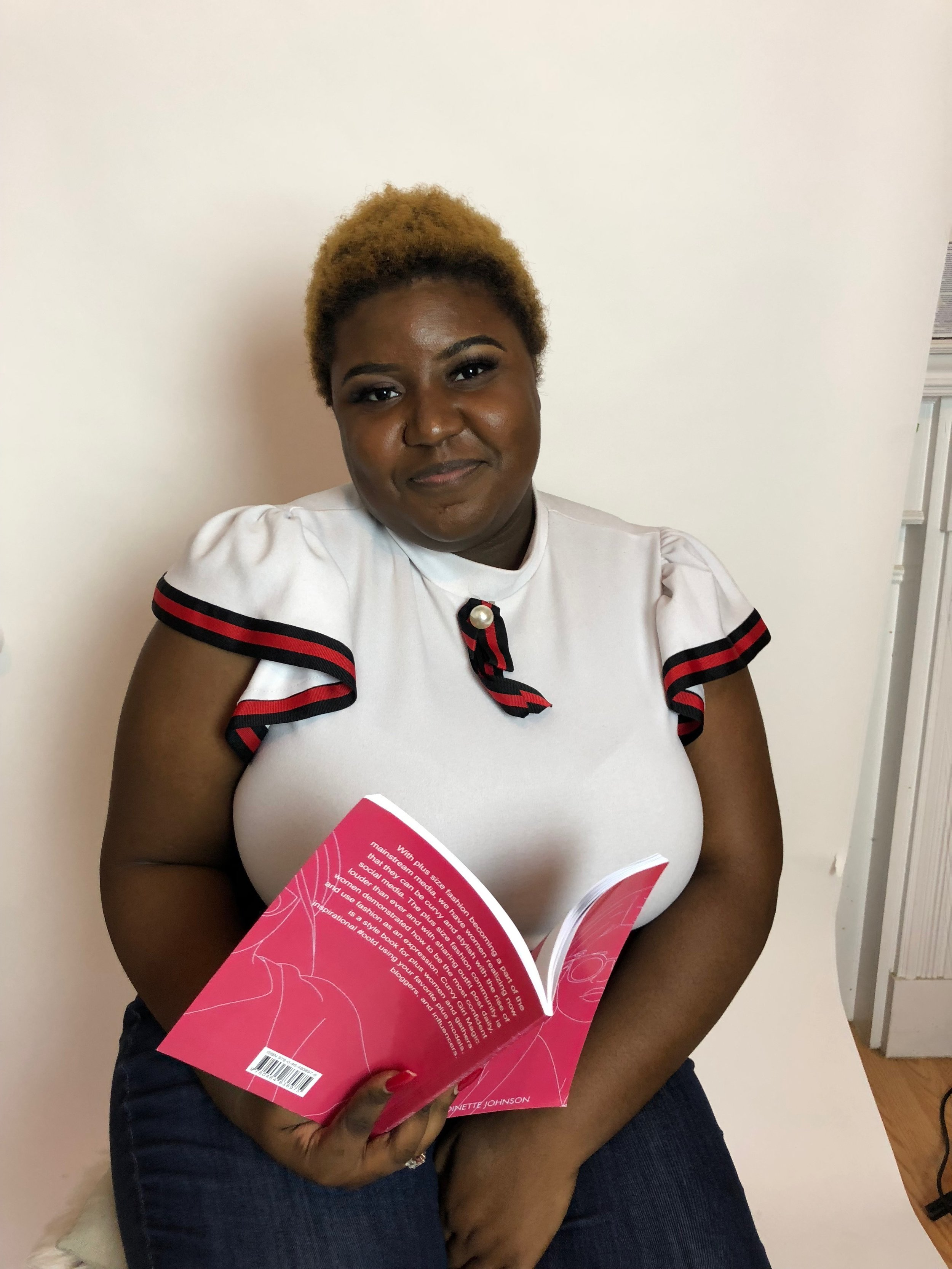 """Antoinette Johnson with her book """"Curvy Girl Magic""""// Image provided by Johnson"""