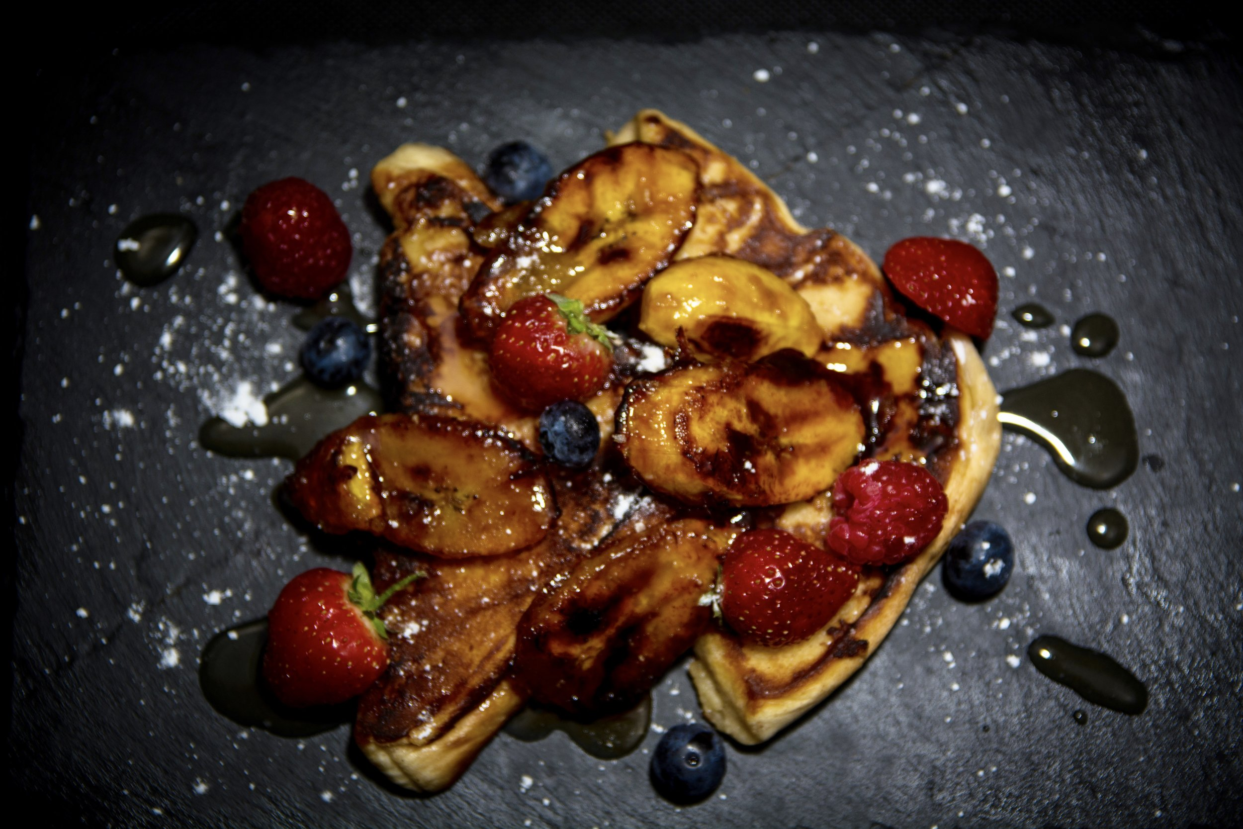 Agege French Toast with mixed berries served with ice cream