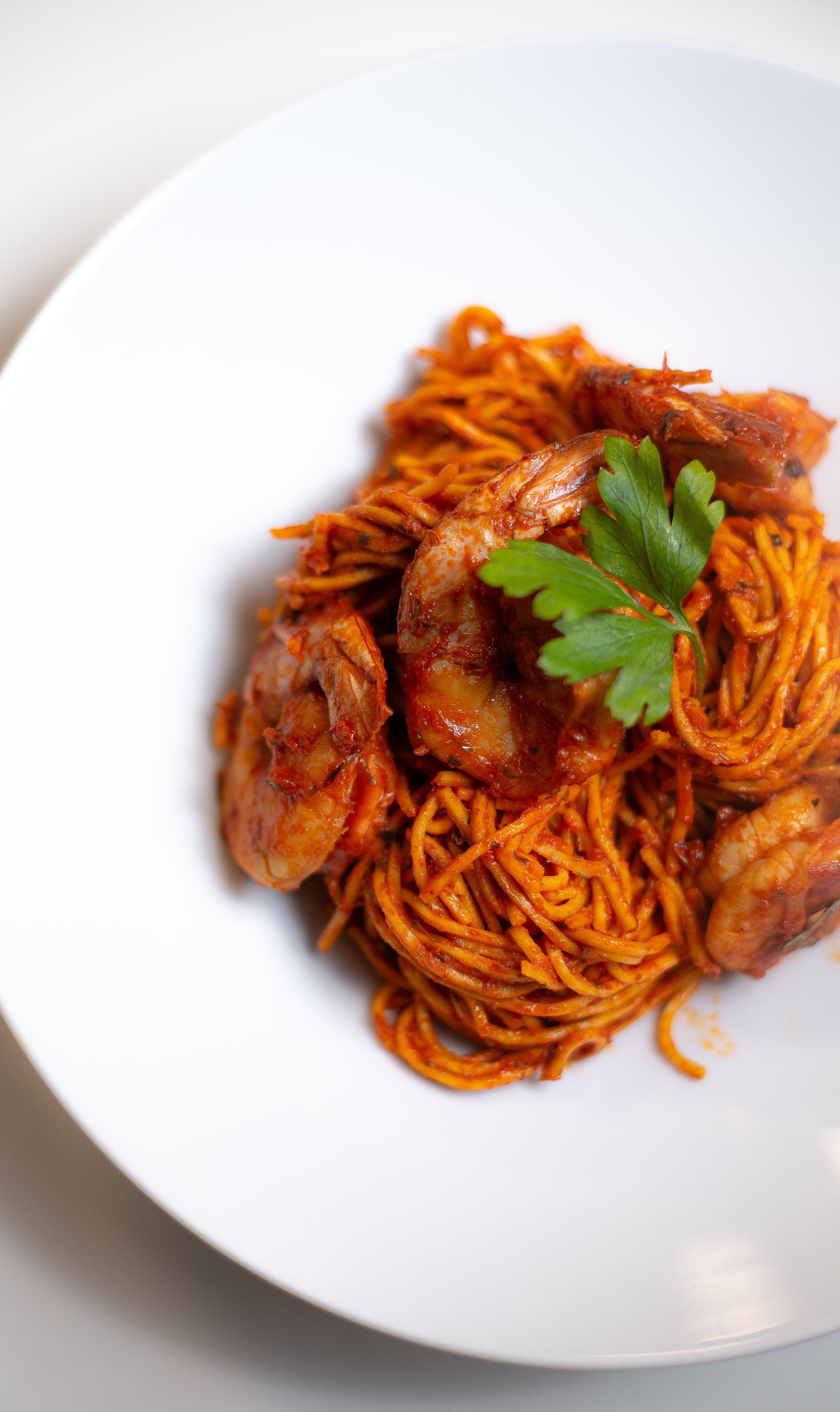 Jollof Spaghetti and Tiger Prawns