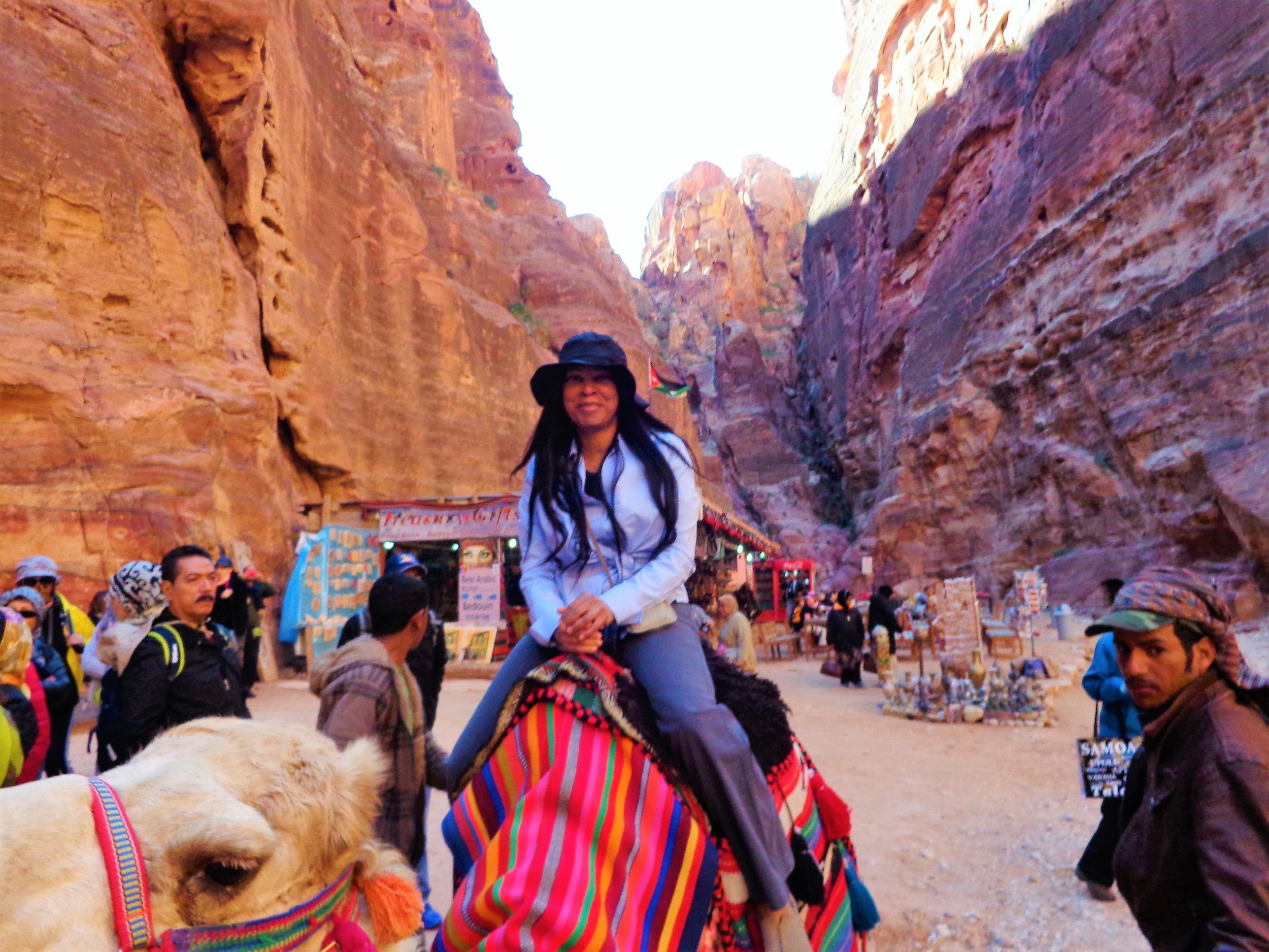 Spotts on a camel in Petra, Jordan // Image provided by Spotts