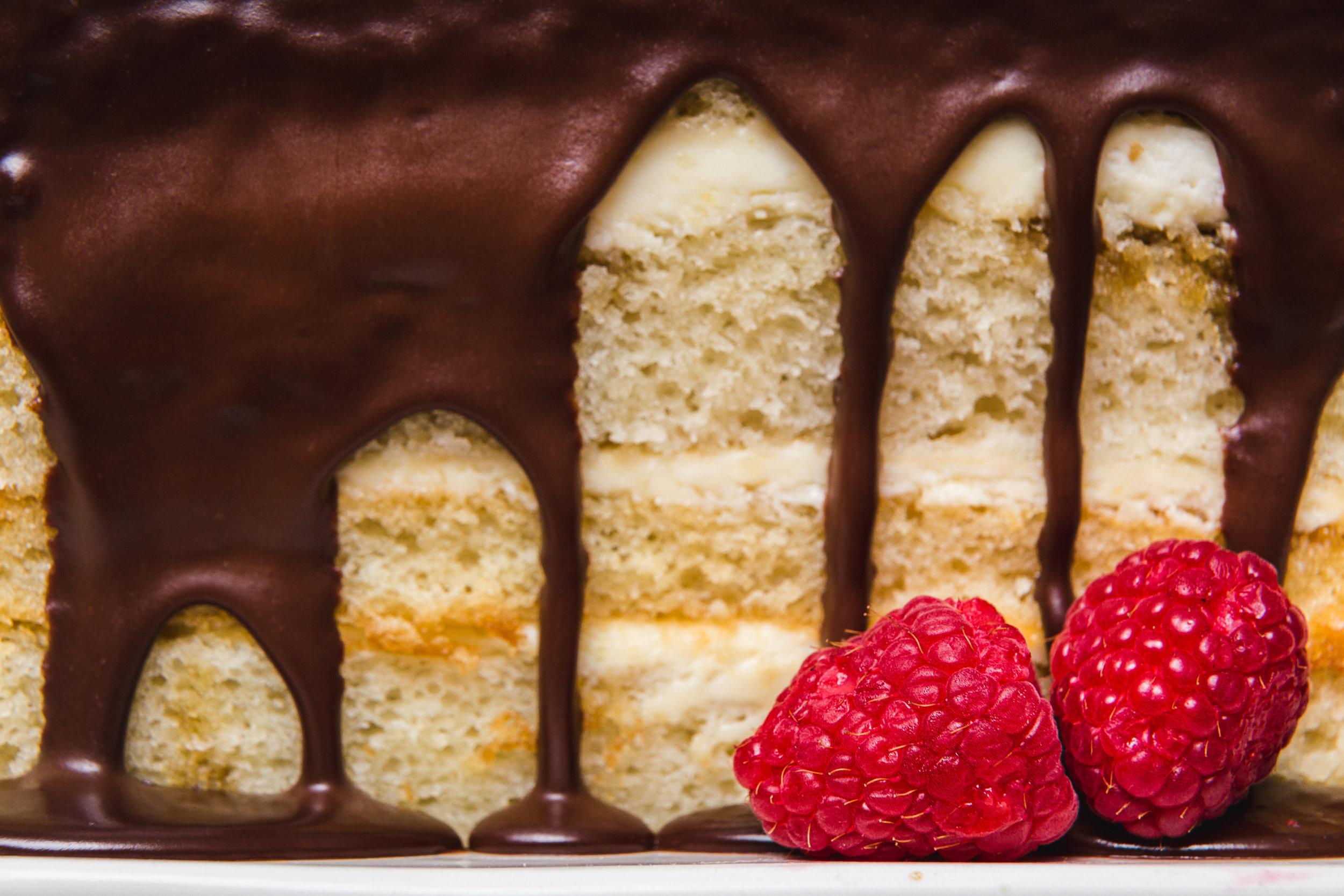Boston Cream Pie Garnished with Plump Raspberries