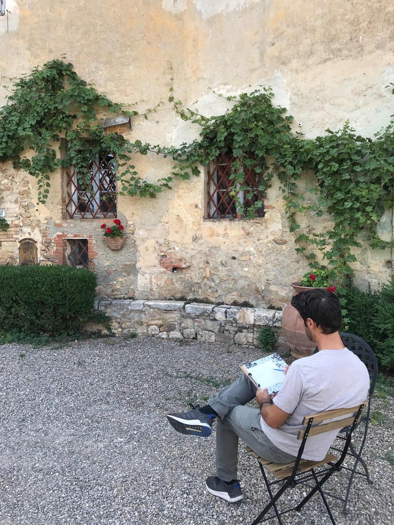 Me drawing at Tenuta di Spannocchia, Italy, 2019