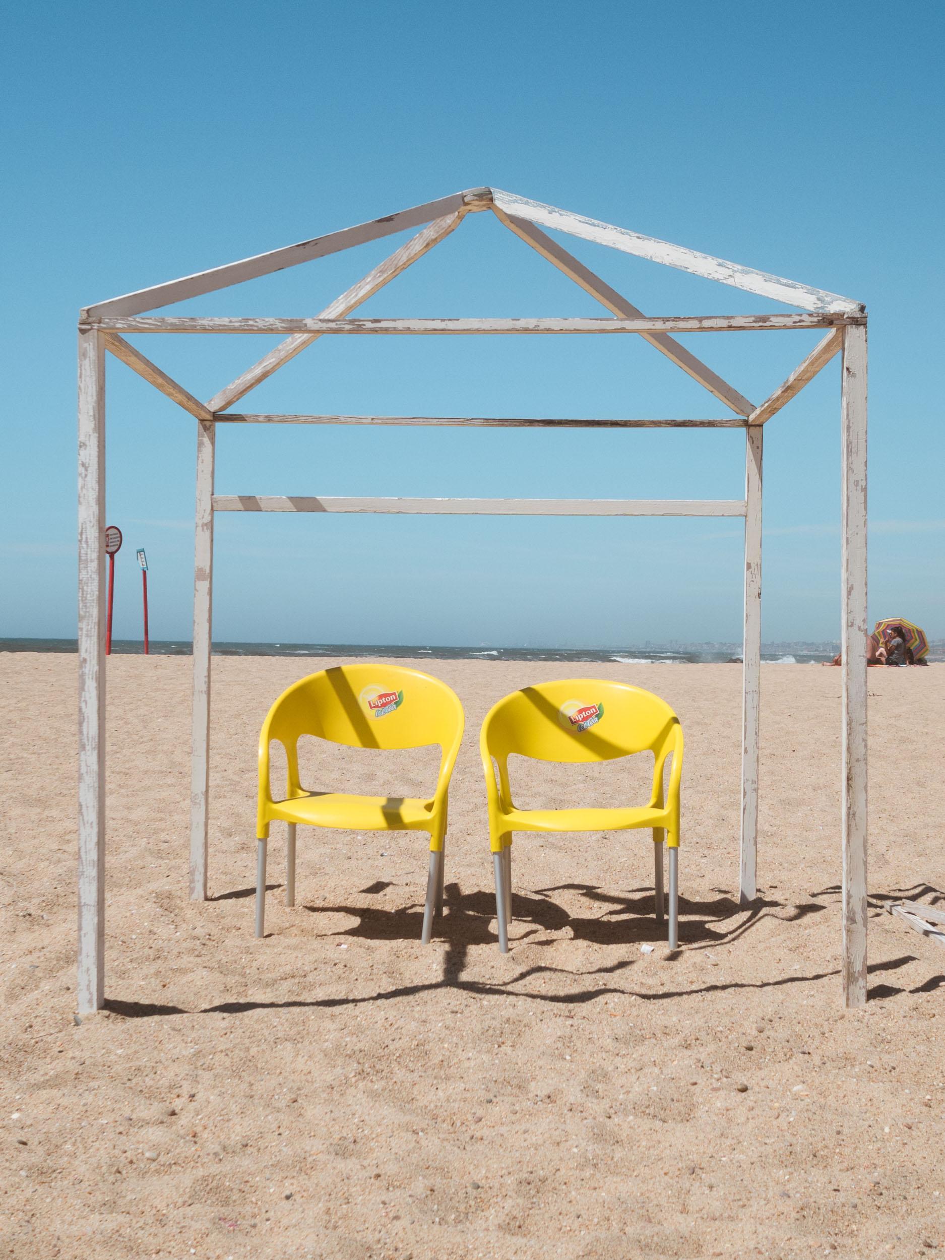 Beach chairs on Praia do Senhor da Pedra near Porto in Portugal.