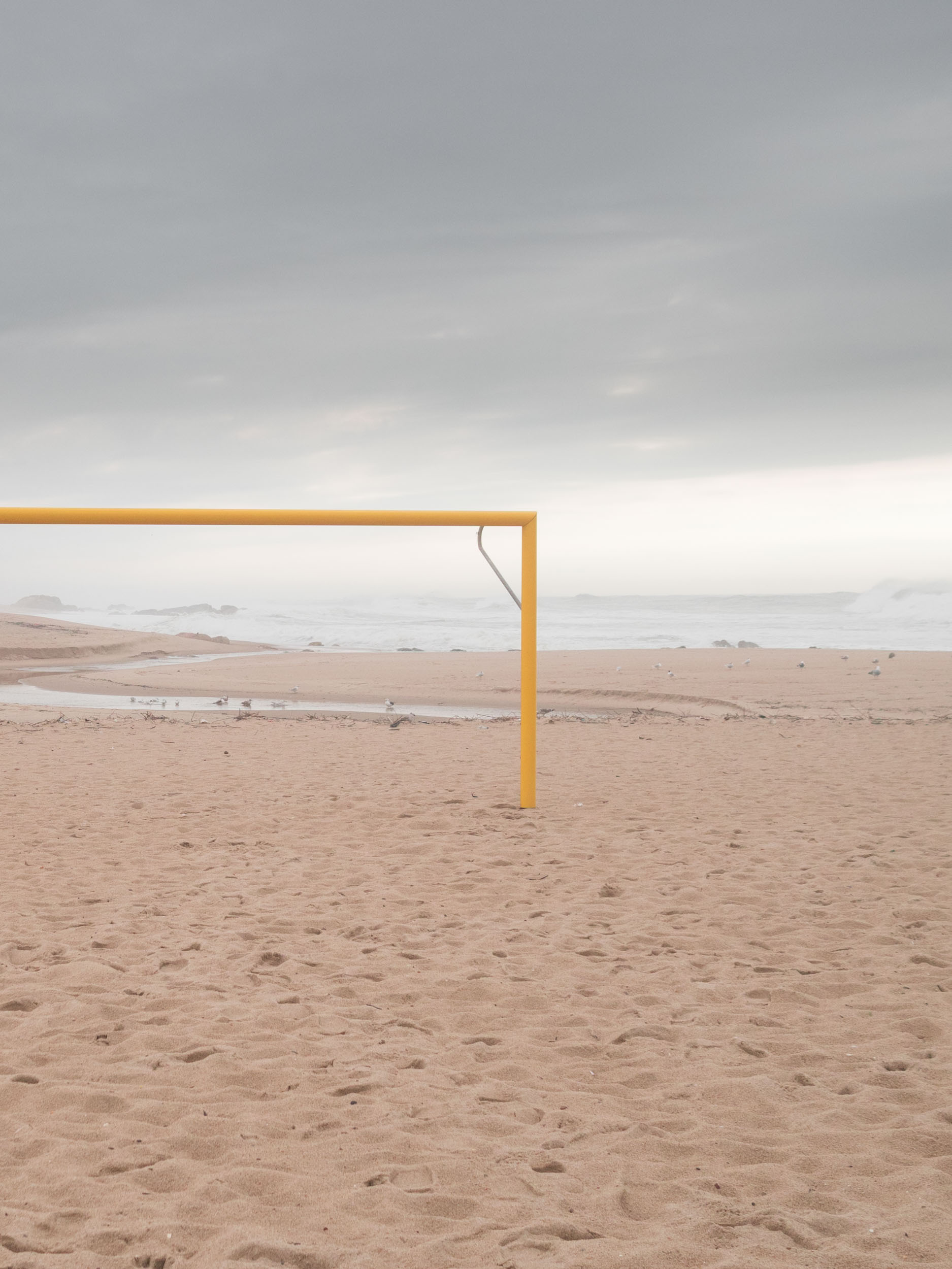 Empty football goal on a beach in Portugal.