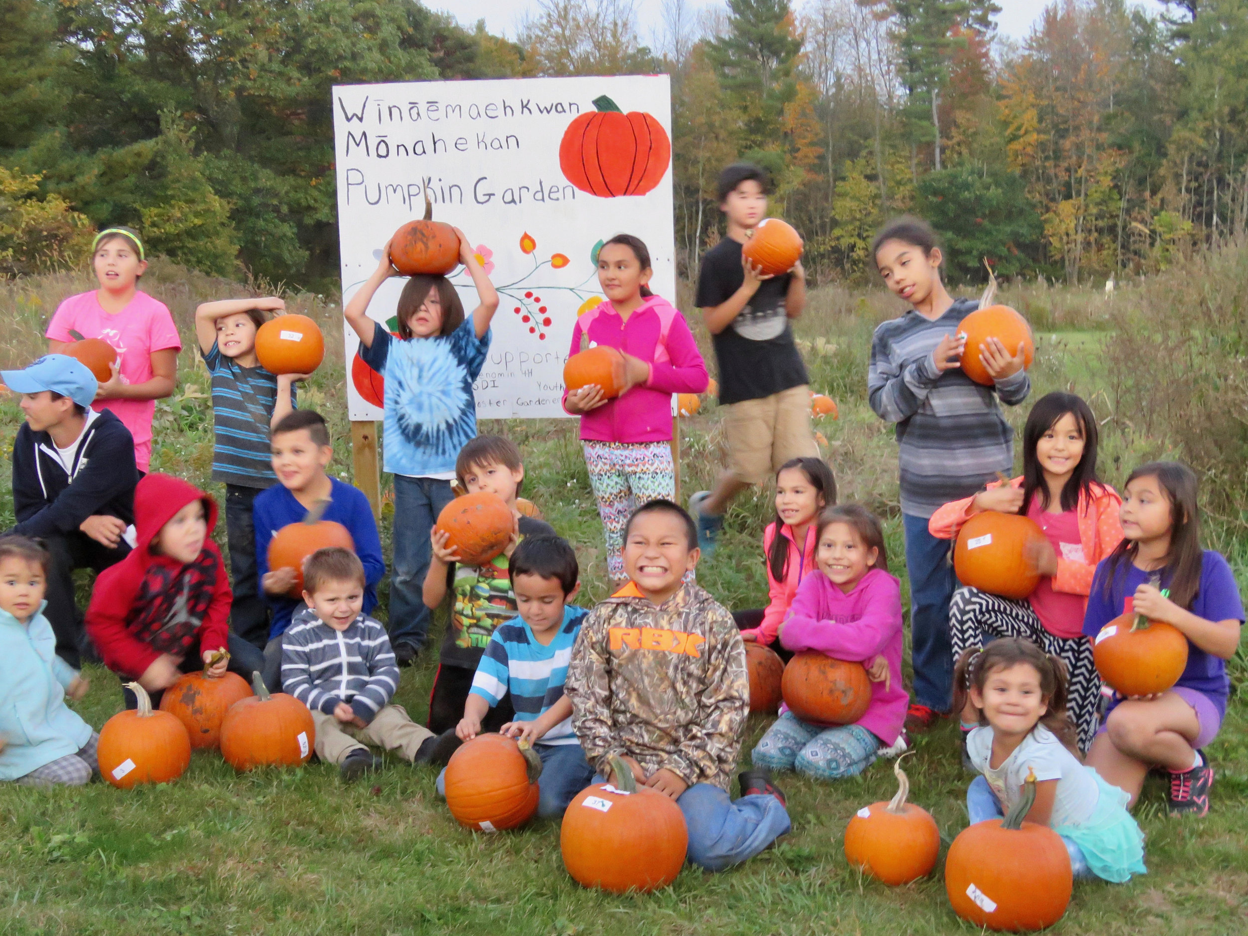 Happy children with their harvested pumpkins on the Menominee reservation.
