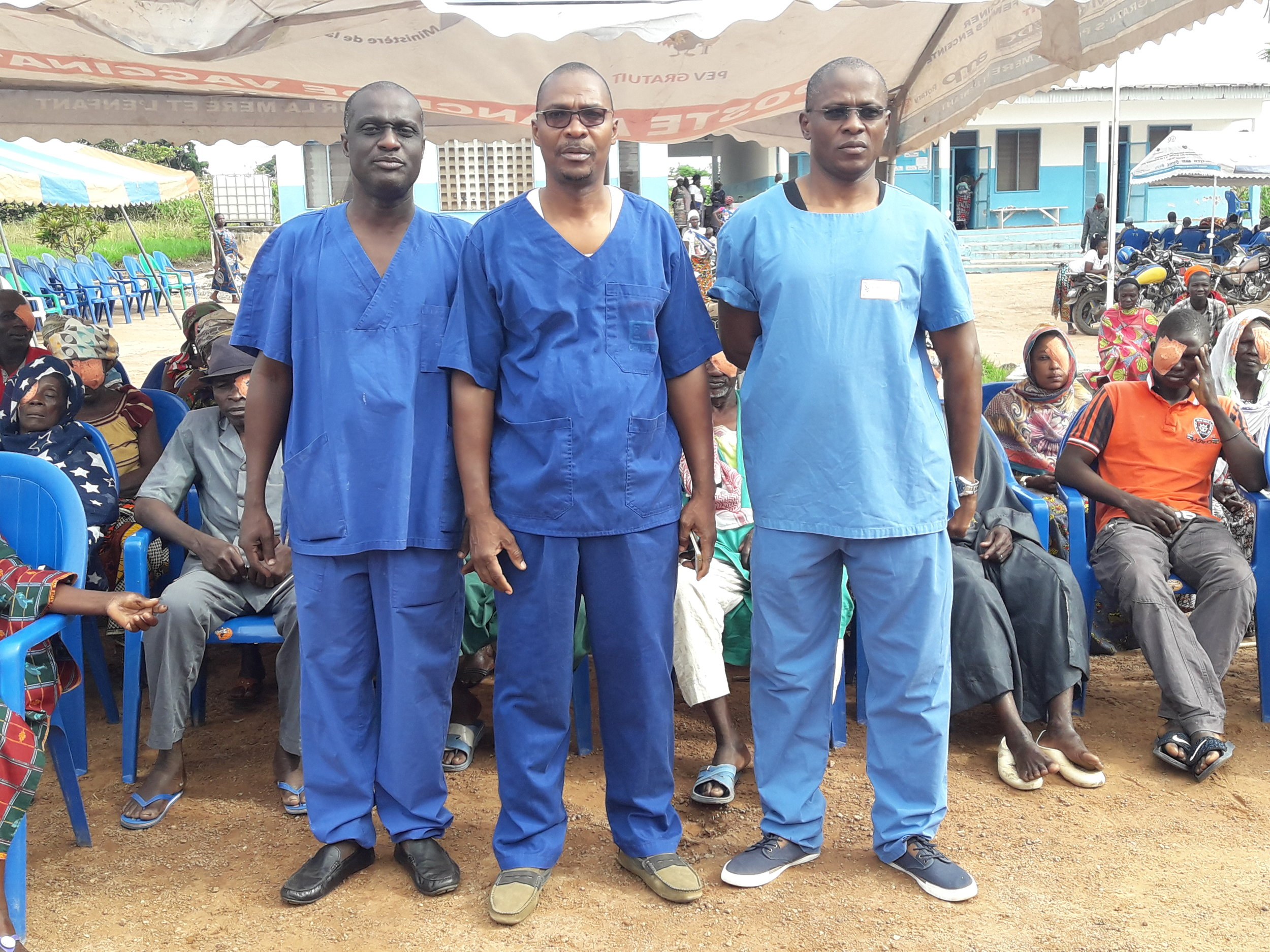 Jeremie Agre (left) performs hundreds of eye surgeries every year in rural areas of Côte D'Ivoire.