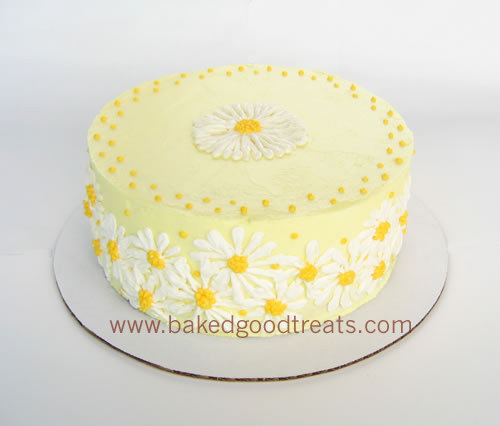 A cake with lemon buttercream and lemon filling gets a happy treatment with a pattern of daisies... inspired by wallpaper from my childhood.