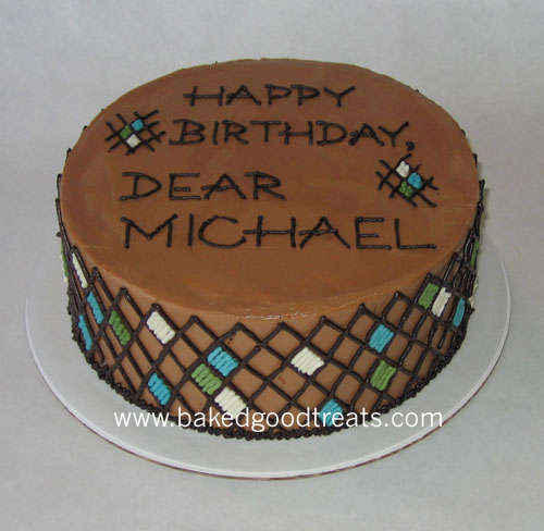 A cake for the discerning gentleman: a simple pattern with key colors adorned this dark chocolate cake.