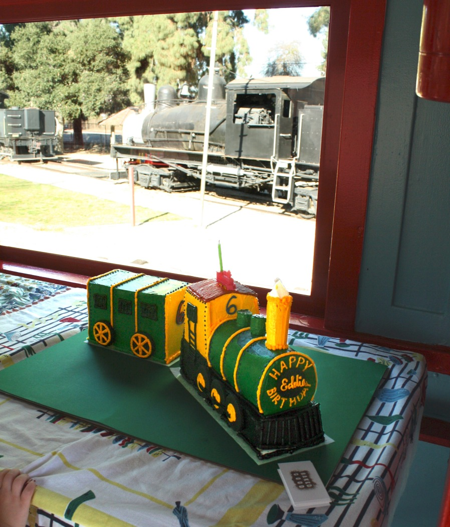 All aboard for a happy birthday! Eddie turned 6 at Travel Town surrounded by his favorite things - trains - in both real and cake form.