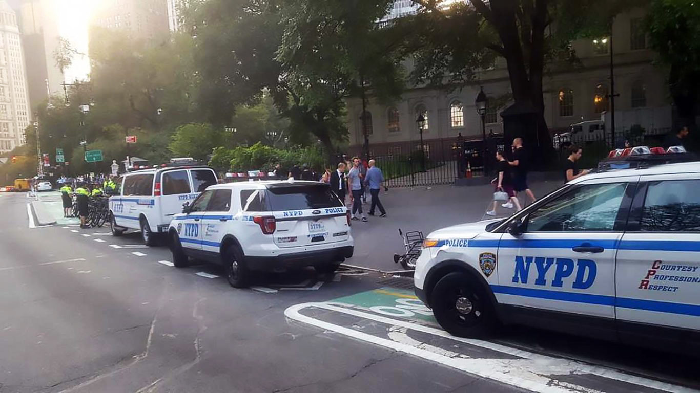 Photo courtesy of @PSteely on Twitter via The Village Voice. The cops getting on their bikes in the background makes this all the more ironic.
