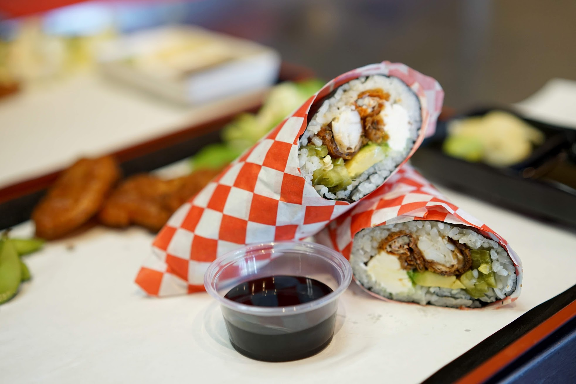 Make Your Own Sushi Burrito with soft shelled crab, cream cheese, avocado, and pickled jalapeños.