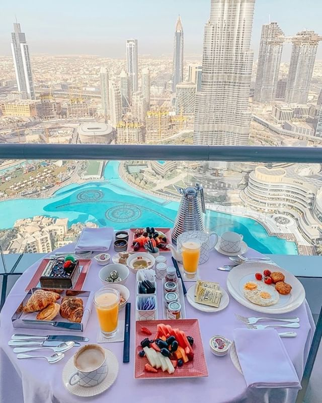 Breakfast with an amazing view In Dubai.  A bit about Dubai: Dubai is a city and emirate in the United Arab Emirates known for luxury shopping, ultramodern architecture and a lively nightlife scene. Burj Khalifa, an 830m-tall tower, dominates the skyscraper-filled skyline. At its foot lies Dubai Fountain, with jets and lights choreographed to music. On artificial islands just offshore is Atlantis, The Palm, a resort with water and marine-animal parks. . Make this your next stop.  Call us today for all-inclusive vacations and tours. Call 305-888-7738. . Pic by @dubaibynael / IG . #dubai #dubaitours #dubaiallinclusive #dubaivacations
