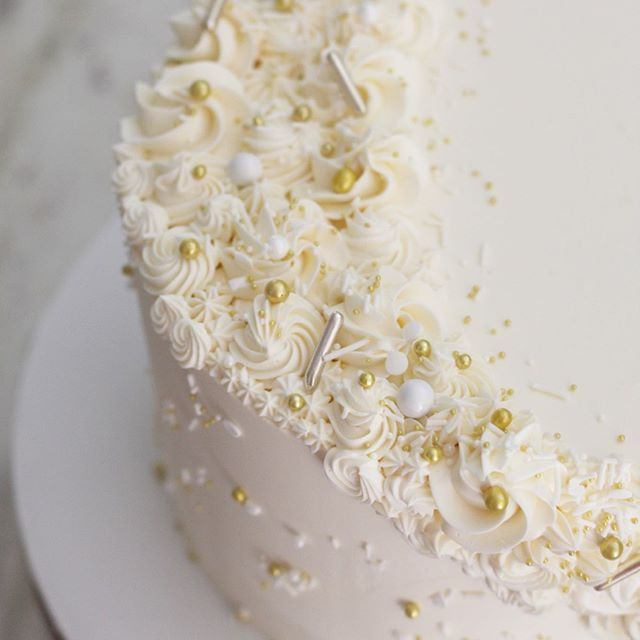 Silently, one by one, in the infinite meadows of the heaven, blossomed the lovely stars, the forget-me-nots of the angels. — Henry Wadsworth Longfellow . . . . . .  #elegantweddingcake #sacramentobakery #weddingbakery #sacramentoweddingcake #sacramentoweddingvendor #sacramentoweddings #weddingcakesacramento #buttercreamcake #thatsdarling #buttercream #goldsprinkles #newtraditions #createyourowntraditions #whiteandgoldweddingcake #fancysprinkles #wedcakestudio