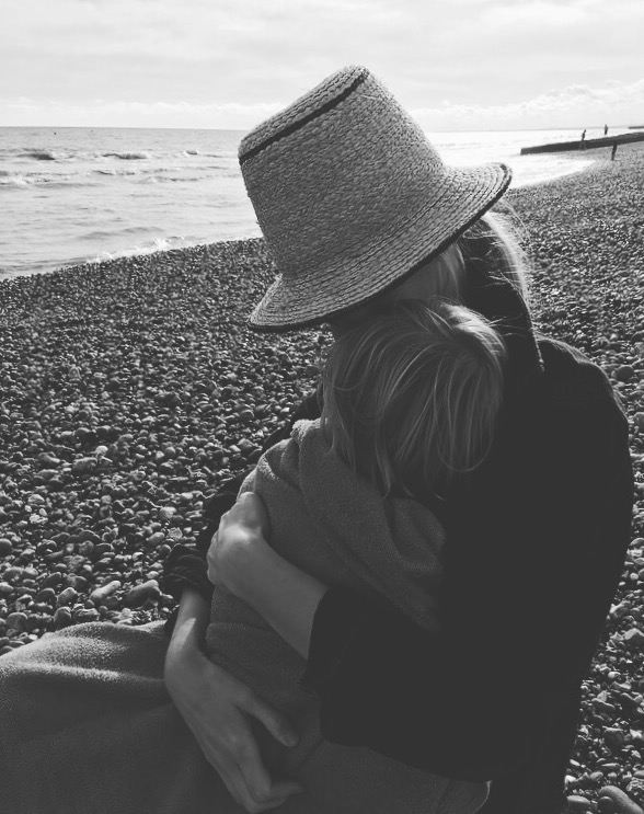 End of an exciting trip. Baby B nodding off to the sound of the waves on Brighton beach.