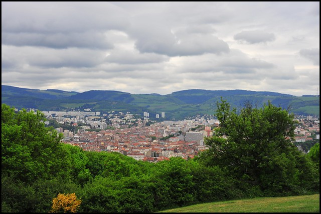 Saint-Étienne with its surrounding hills. Photo by  Richard Weil  . Licenced under  Creative Commons