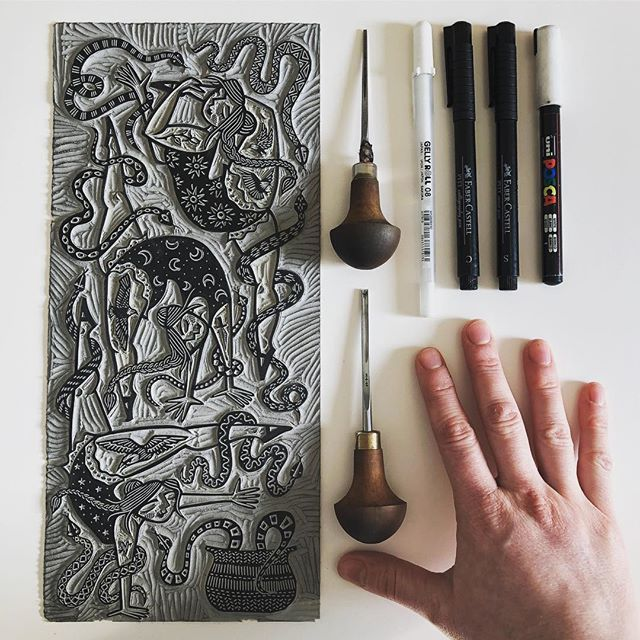 """It's #marchmeetthemaker Day 3! I'm cheekily combining days 2 and 3 so I can catch-up. Honestly, I don't have a lot to say about Day 3's topic 'Flatlay', except """"Here are some of my printmaking things. I have laid them out flat on my desk. My hand needs some serious moisturiser."""" . When I'm in an Instagrammy mood it can be quite fun arranging things in a really anal way, but I definitely tend towards the utilitarian rather than the aspirational and the bulk of my feed is work in progress because I feel like it communicates more about what I actually do than a beautiful fait accomplis shot (although I definitely sneak one in from time to time). Also, I'm lazy, and it's much easier to just capture reality as I go. . As to Day 2, """"How you started..."""" - I accidentally covered it a bit yesterday, but here's a little more: * I'm a self taught, muddling-through kind of printmaker. I did art at school but studied Philosophy and Psychology at uni. I came to linocut in my thirties. * Why linocut? I honestly don't know.  My stepmum is an art teacher and gave me a brilliant present about ten years ago - a whole stack of student linocutting supplies. I dabbled for fun but nothing serious until a couple of years ago when, from nowhere, I decided to try it again. I can't even remember why!! It was all pretty rough-hewn and basic at that point, but I liked the edge it gave to my drawings. * I got new cutting tools for my birthday in 2017 (my beloved Pfeil ones) and they immediately changed what I was able to carve - it was like swapping from a push-along scooter to a massive motorbike. It became addictive, and calming (I'm an extremely fraught kind of person), and more fun the more I tried to challenge myself. I started posting my work on here and discovered there were people out there who liked it enough to buy prints - who knew?!? * As print sales have grown, I've changed the balance of what I do. I had been combining freelance design work with printmaking and hand-painted ceramic"""