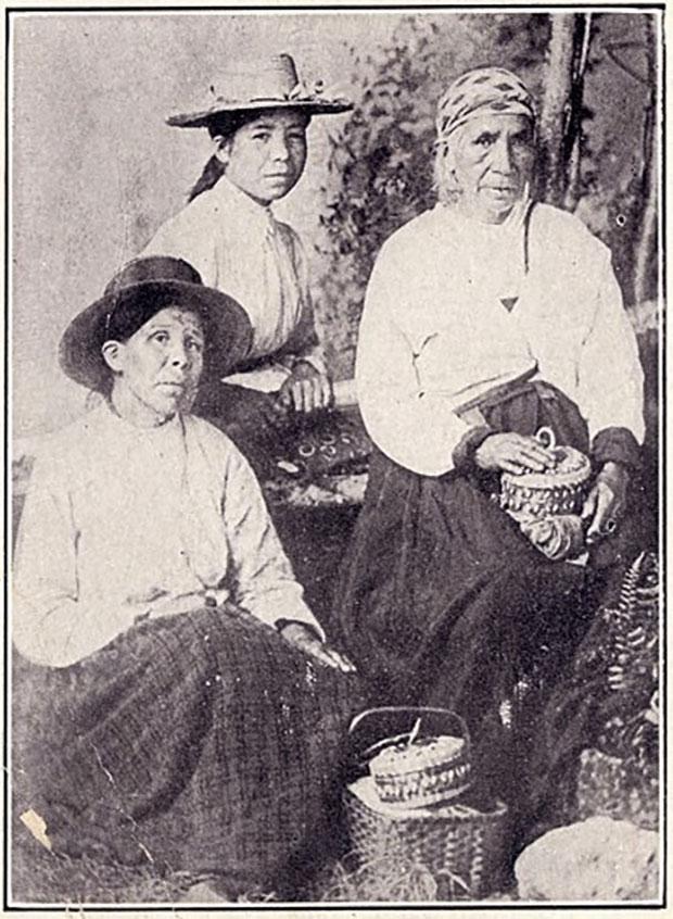 """Three Mi'kmaq women holding woodsplint baskets"""" ca. 1890"""