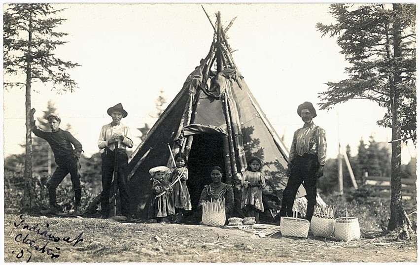 """Mi'kmaq group with baskets in front of wigwam, Chester"""" ca. 1910"""