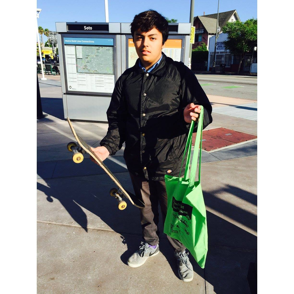 Jonathan riding his skateboard and taking the Gold Line on his way to school!