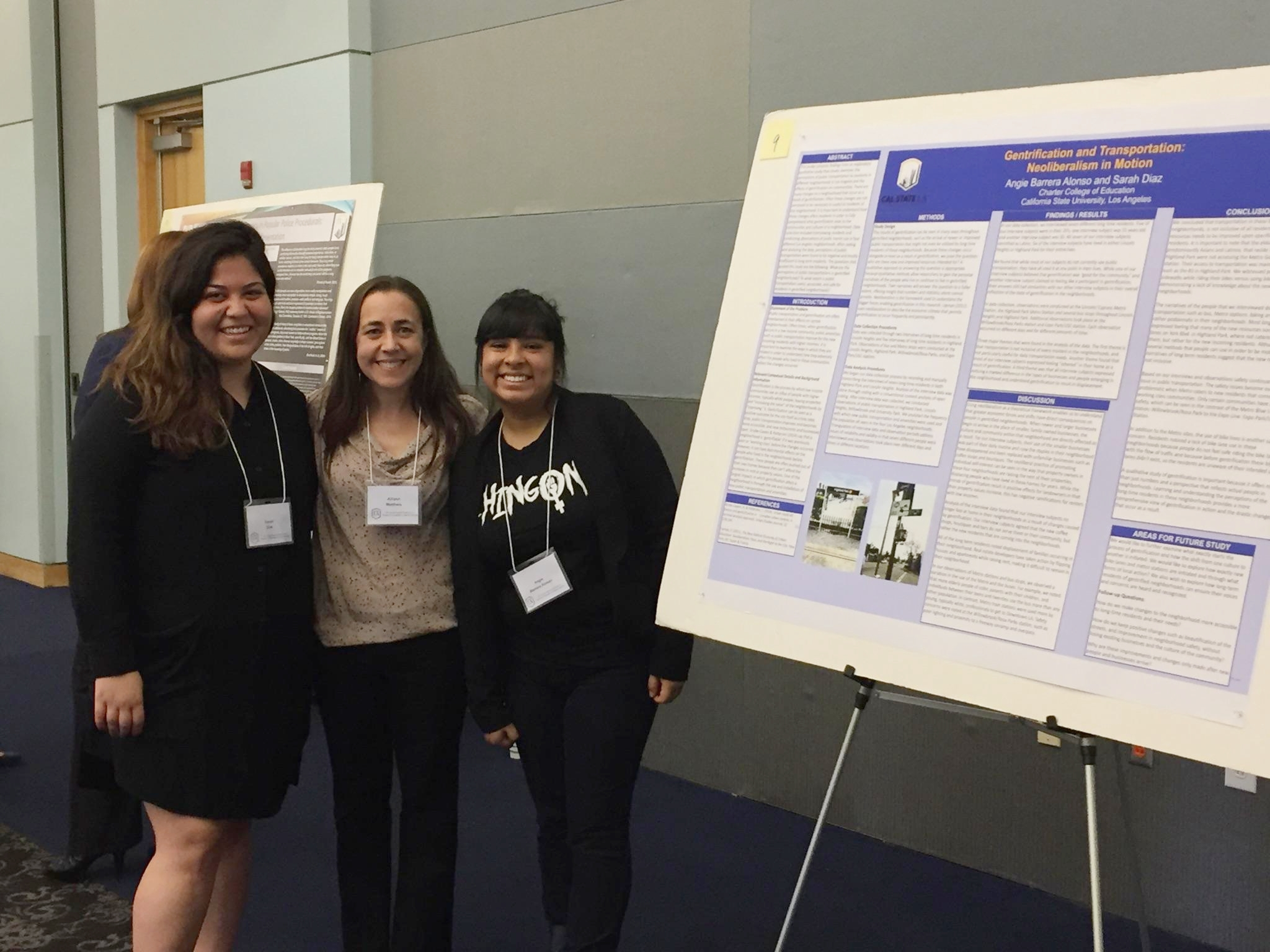 "Dr. Allison Mattheis (center) with two students who presented a poster entitled ""Gentrification and Transportation: Neoliberalism in Motion"" at the February 2017 Cal State LA Student Research Symposium. The poster was based on research with MCM."