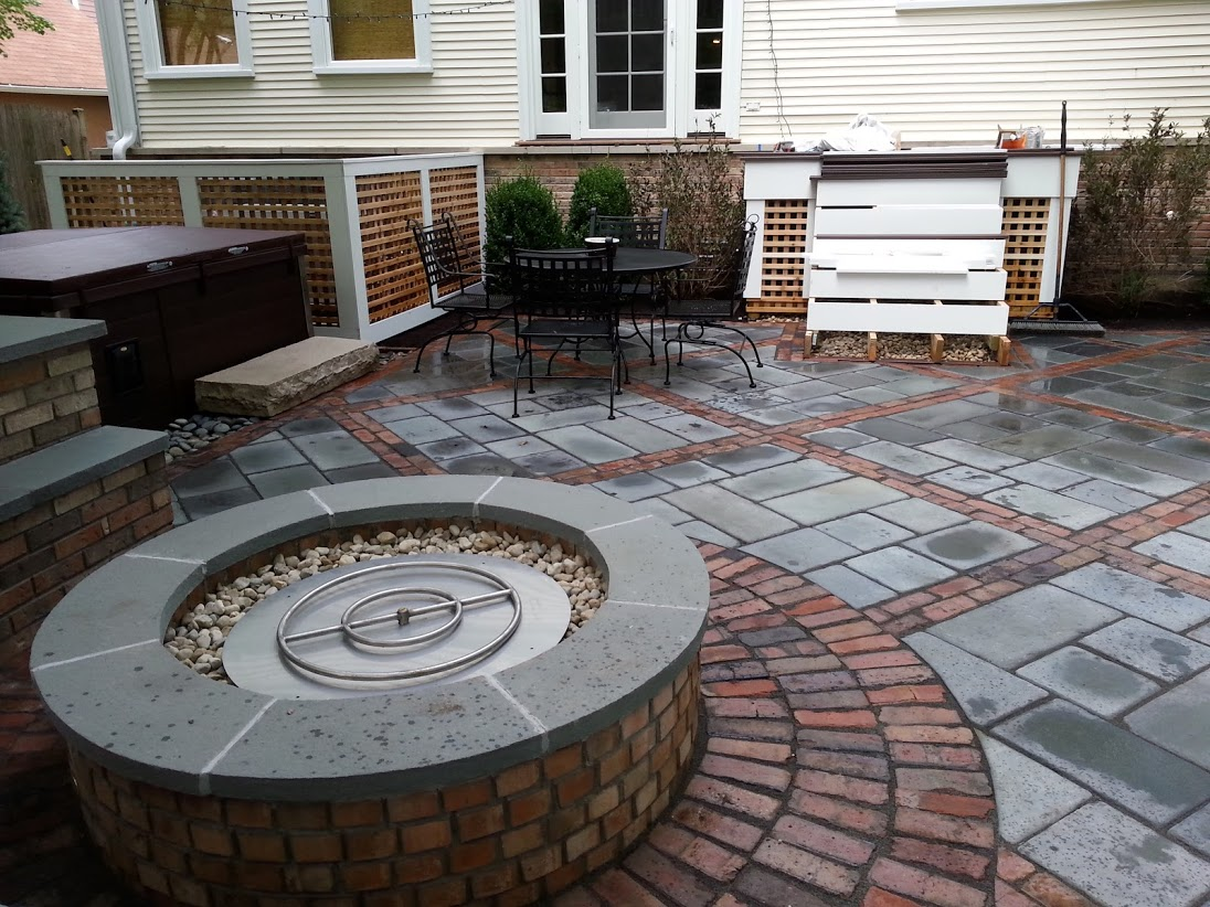 Outdoor fireplace by Unilock contractor in Northbrook, IL