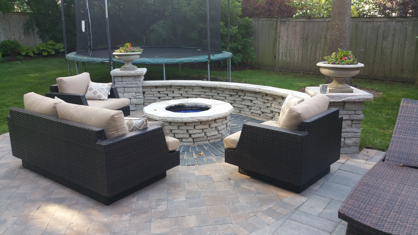 Outdoor fireplace landscape design by Unilock contractor in Northbrook, Glenview, Buffalo Grove, IL
