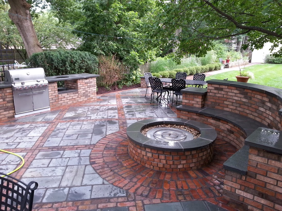 Patio pavers, outdoor fireplace by landscape contractors in Buffalo Grove, IL