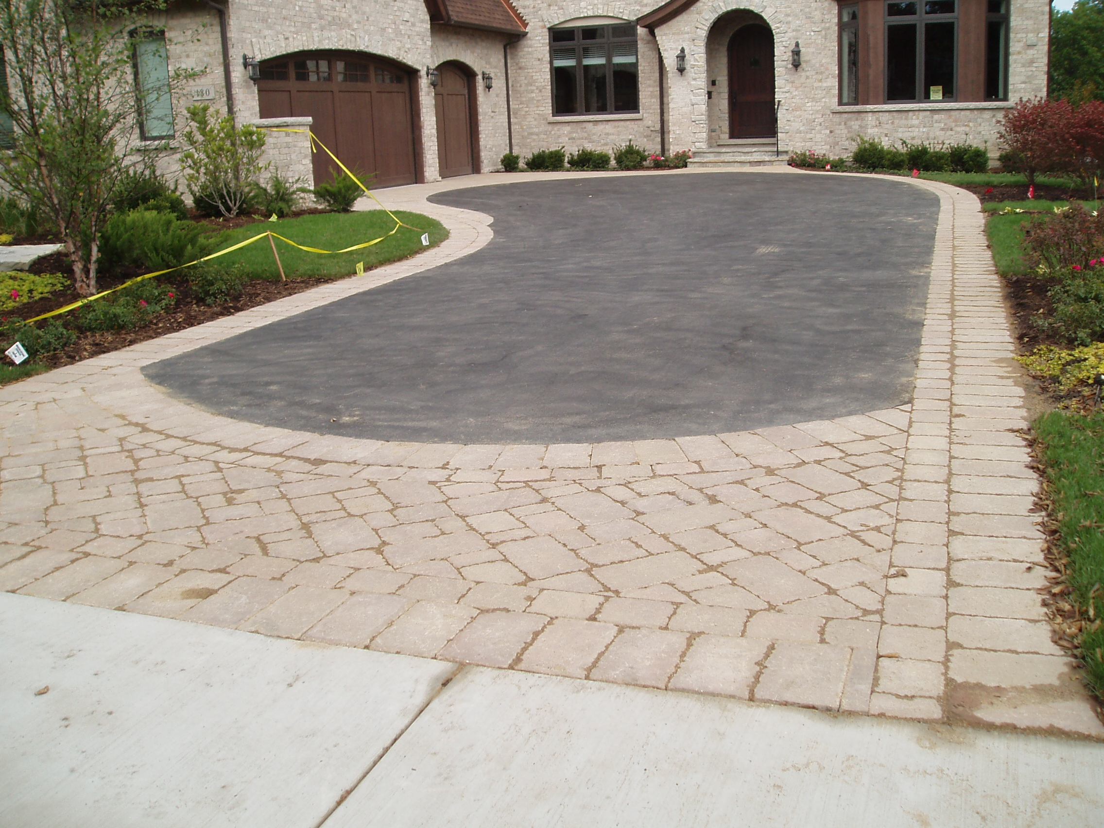 How the Unilock Financing Program Can Help Supply New Patio Pavers for Your Driveway Remodel in Highland Park, IL