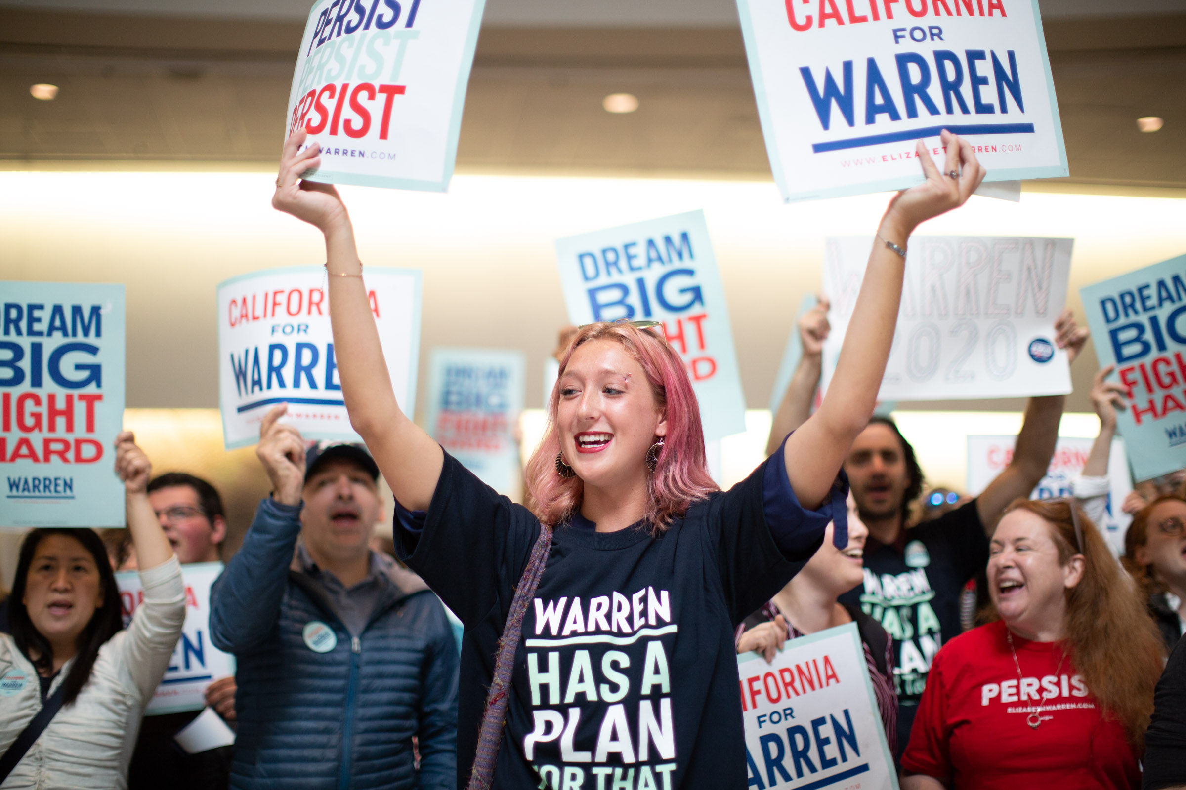 "Elizabeth Warren for President supporters with ""Warren Has a Plan for That"" t-shirts and signs, June 1, 2019, at California Democratic Party convention at Moscone Center, San Francisco, CA. Photo by Tumay Aslay"