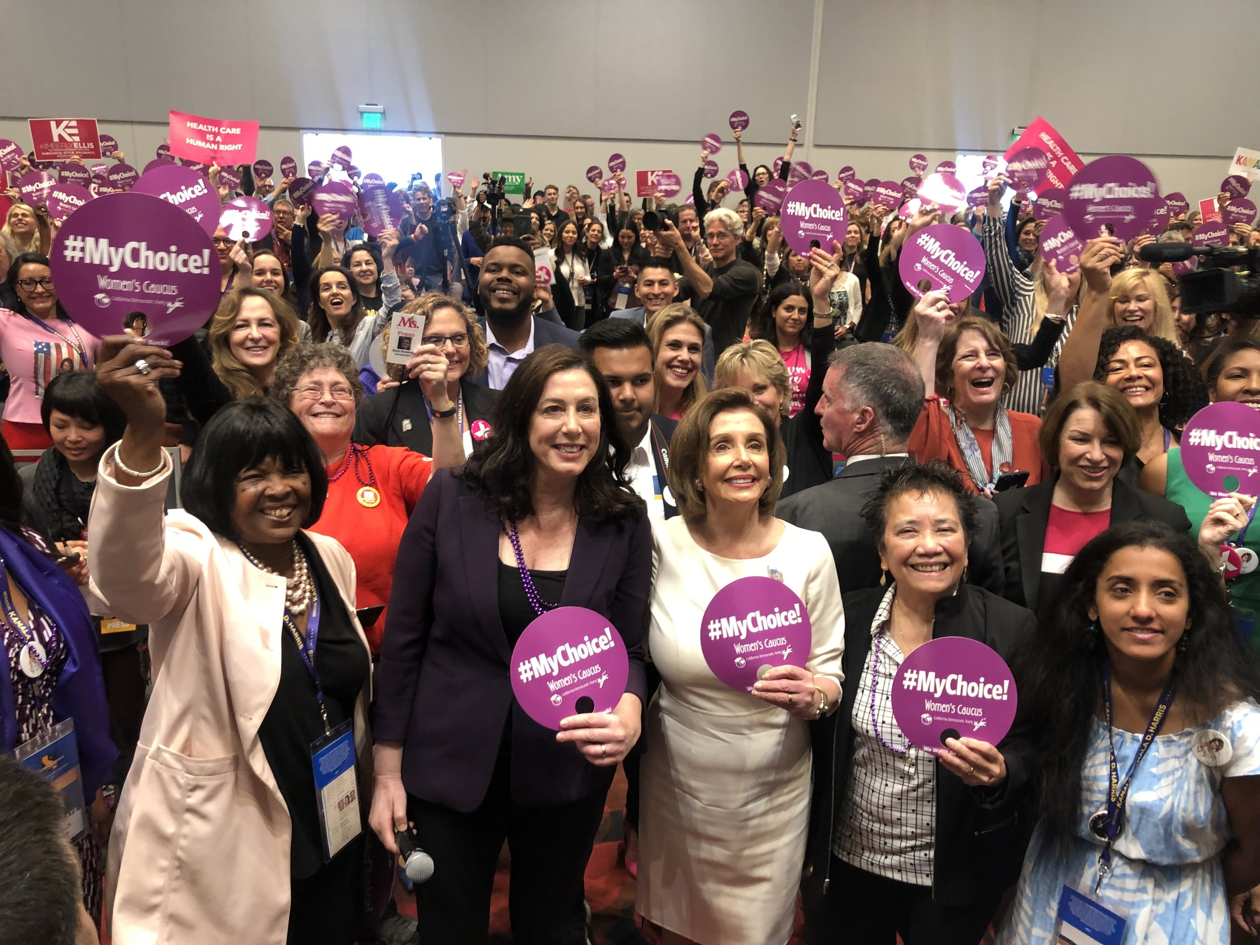 Christine Pelosi and House Speaker Nancy Pelosi surrounded by a crowd at the Women's Caucus event at the California Democratic Party convention, on June 1, 2019, in San Francisco. Photo by Tumay Aslay