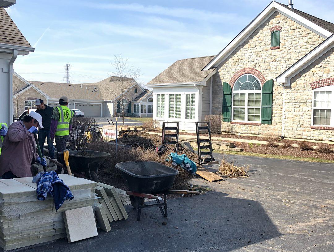 Landscape construction of brick patio and brick driveway in Oak Brook, IL