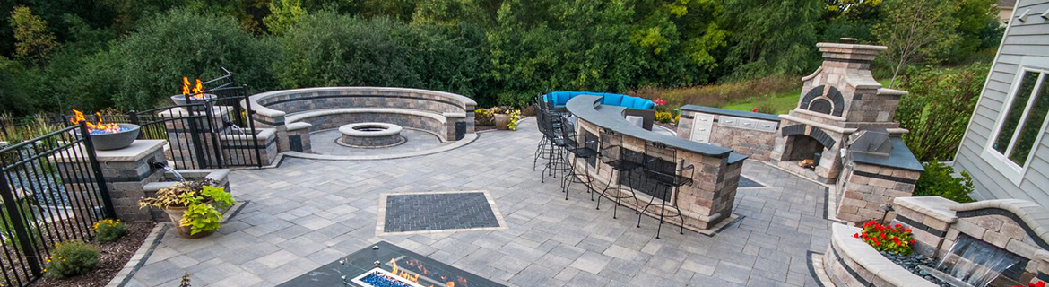 Stunning brick patio, outdoor kitchen and fireplace in Elmhurst, IL