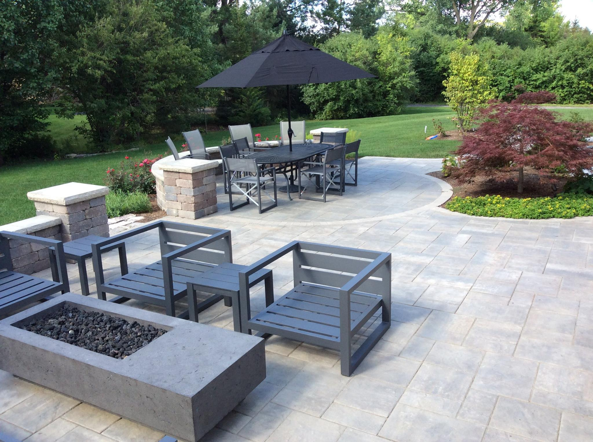 Outdoor fireplace and brick patio in Oswego, IL