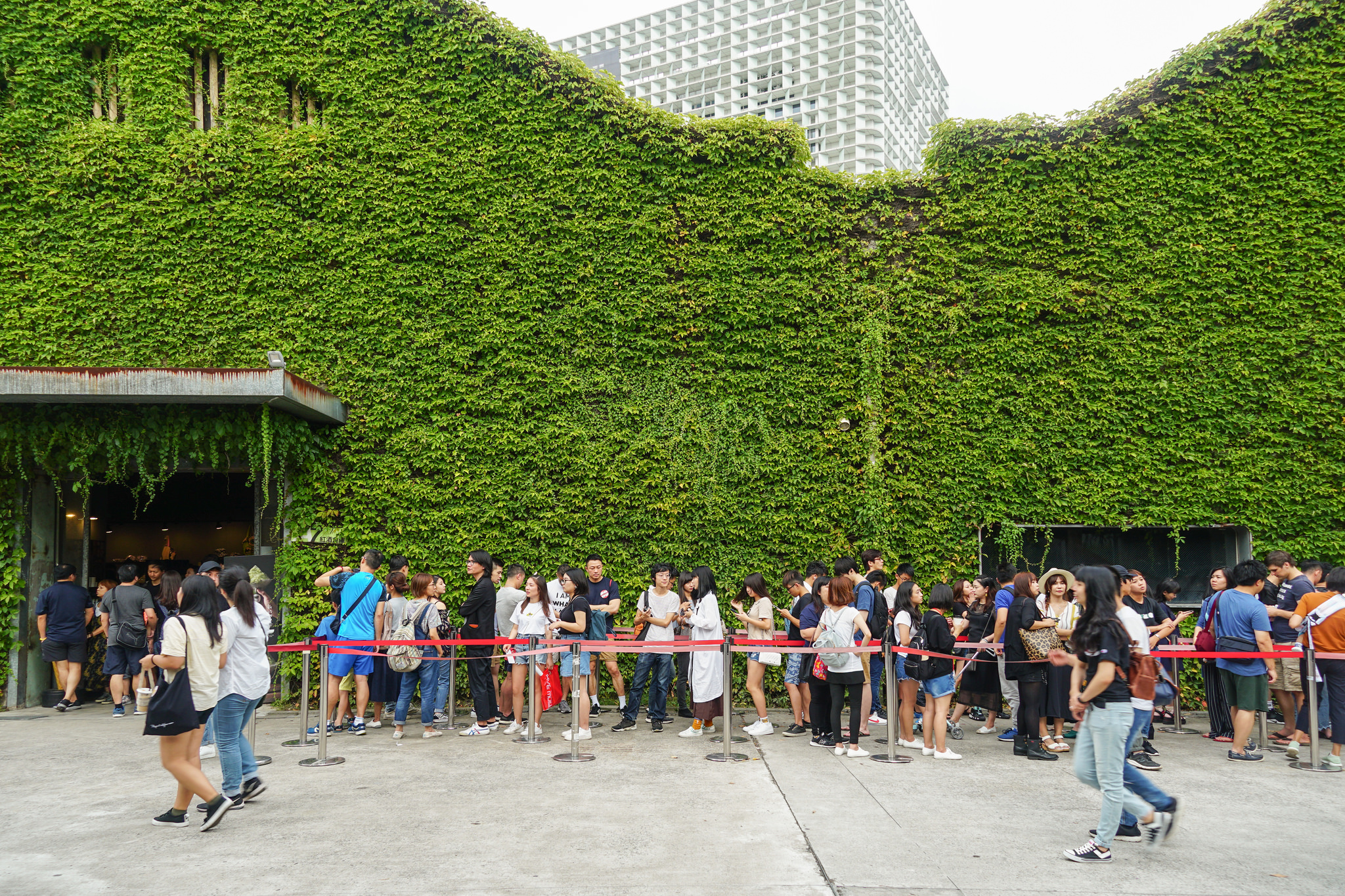 Visitors wait in line for an exhibit in this Former Sake winery turned art space; complete with cinema, galleries, cafes, a microbrewery and gift shops.