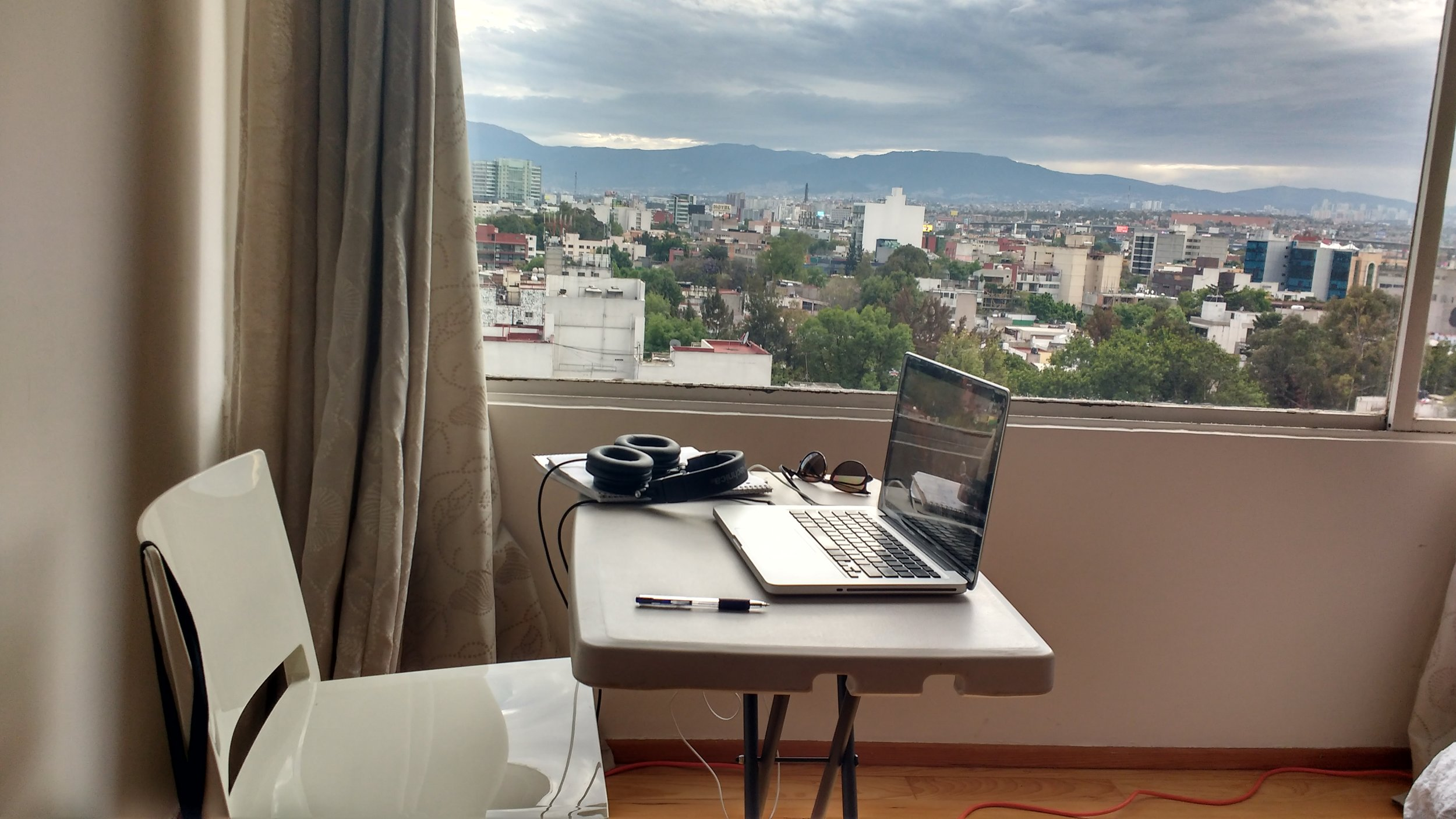 Workspace in our private room airbnb in Mexico City. This was the last time we rented a private room. My early morning classes bothered our hosts. This is why clear communication with your host is so important.
