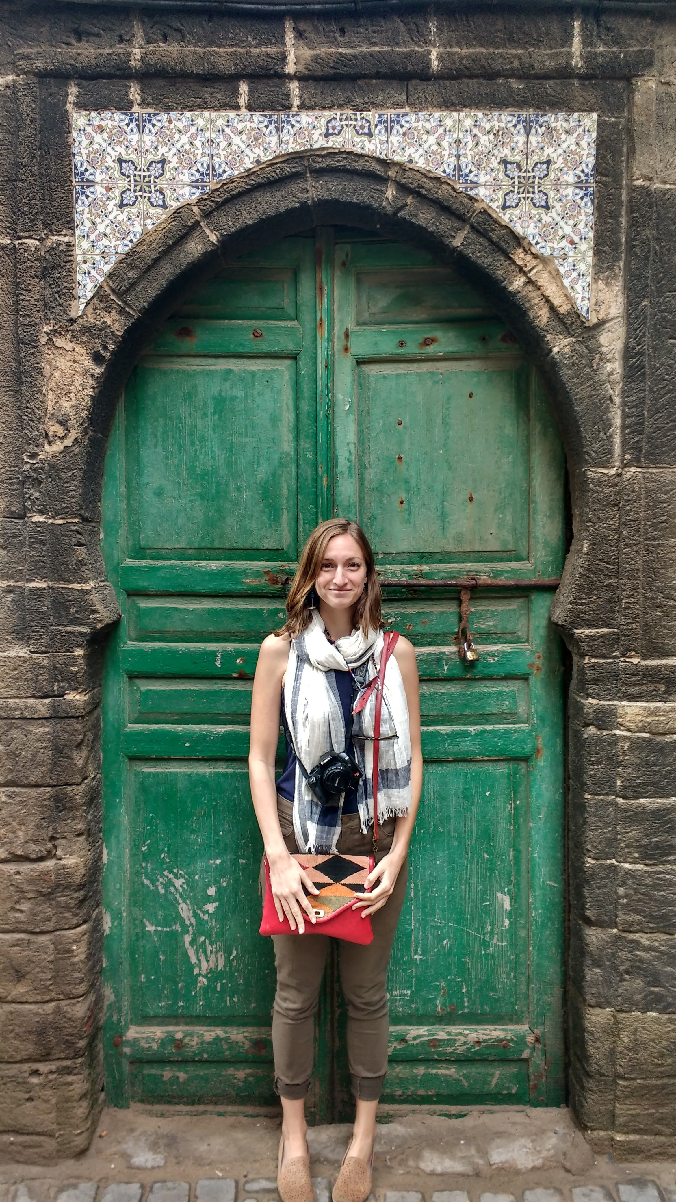 Morocco; this was as much skin as I was willing to show in Morocco. Bought the scarf in Marrakech and the new purse in Fez. Otherwise wearing a light high neck navy cotton blend tank with light green skinny pants and Merrell leather loafers.