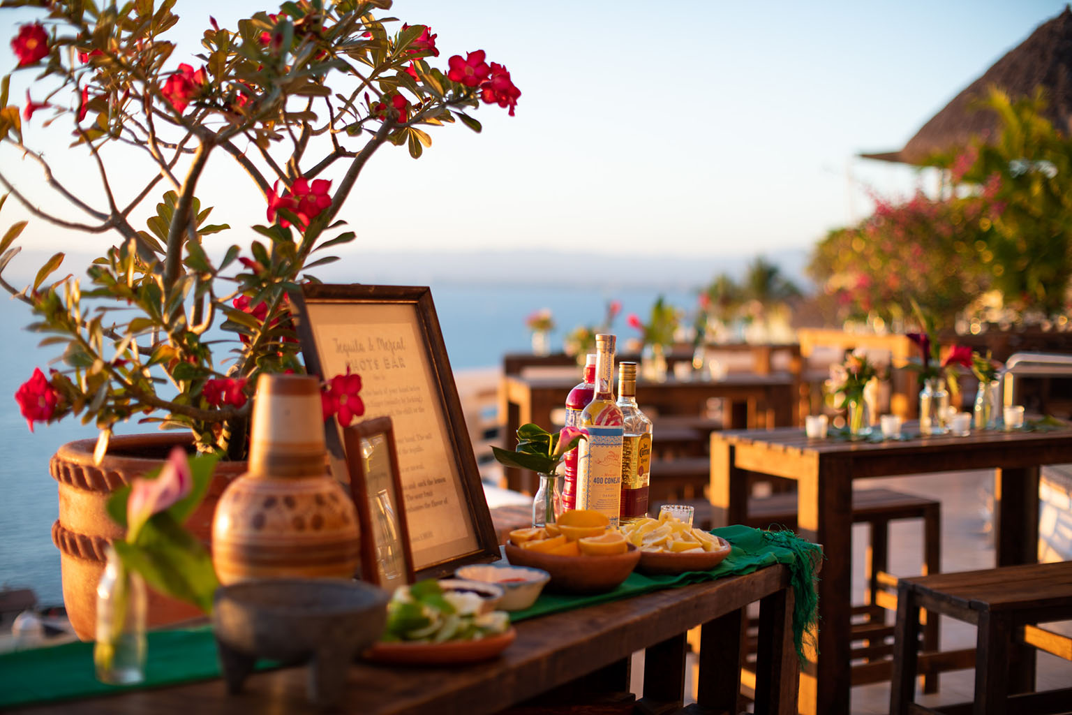 The self serve tequila and mezcal bar, overlooking the bay at sunset. Photo by  Cristheell Bernal