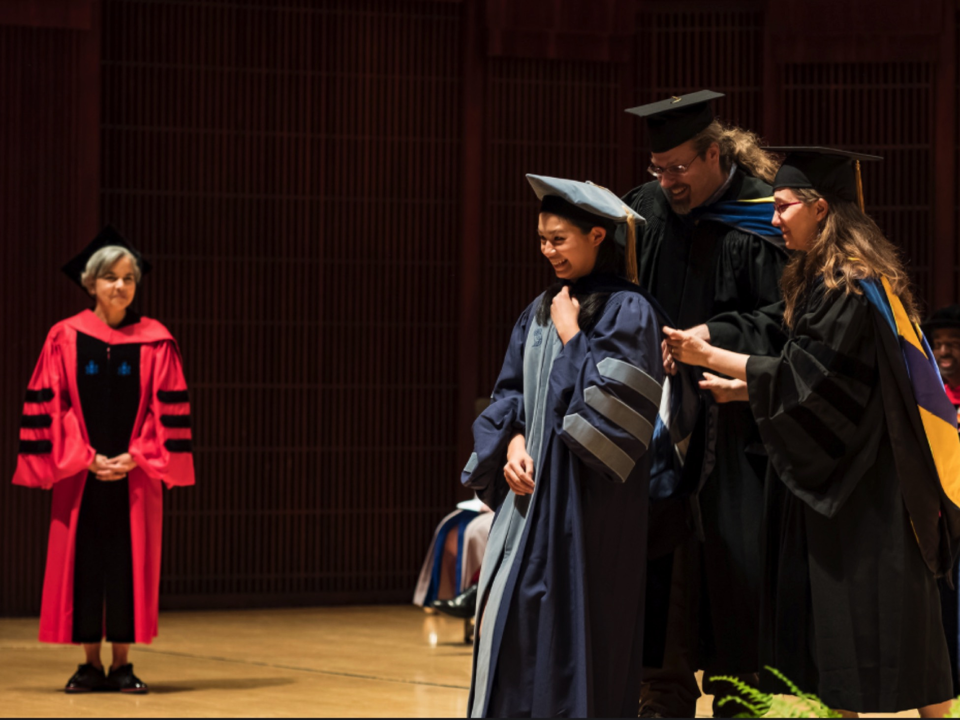 Shelly's hooding at the 2018 graduate convocation