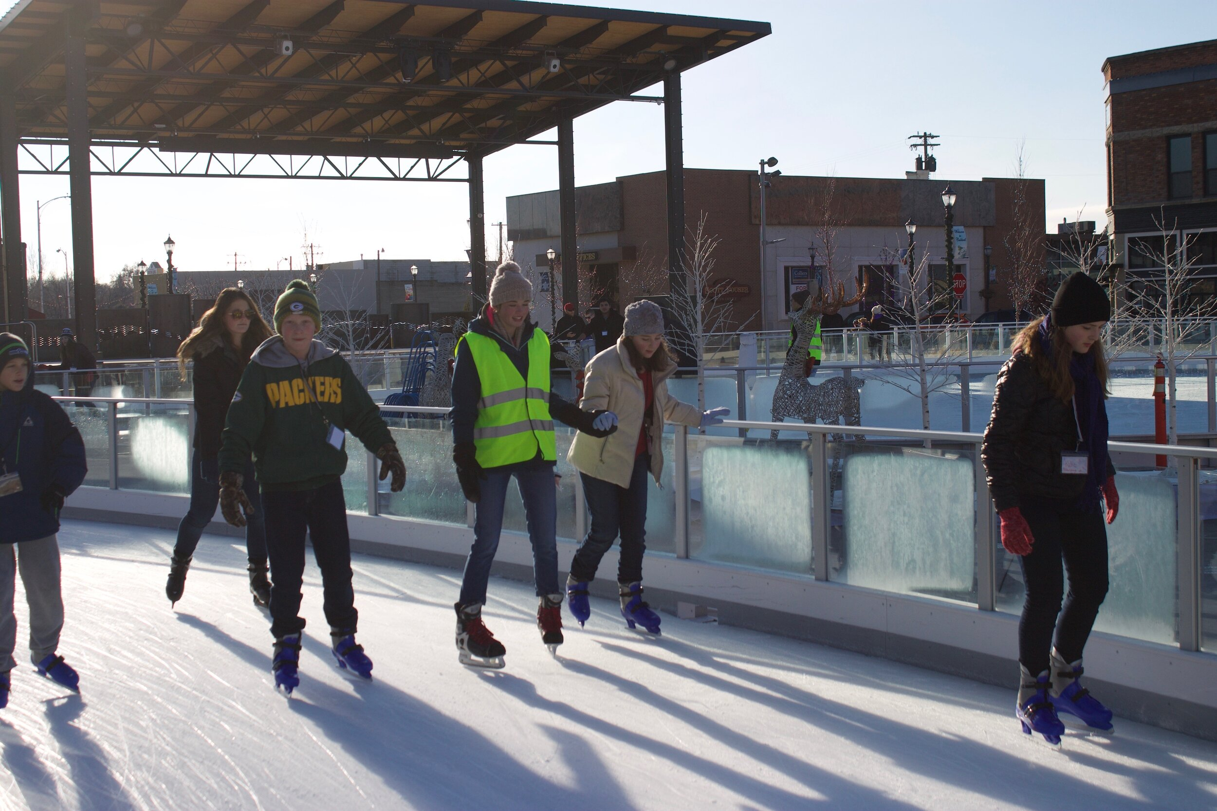 Volunteers offer additional support during free skate