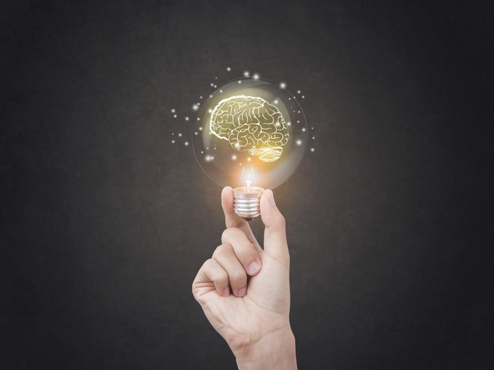 hand-holding-brain-lightbulb.jpg