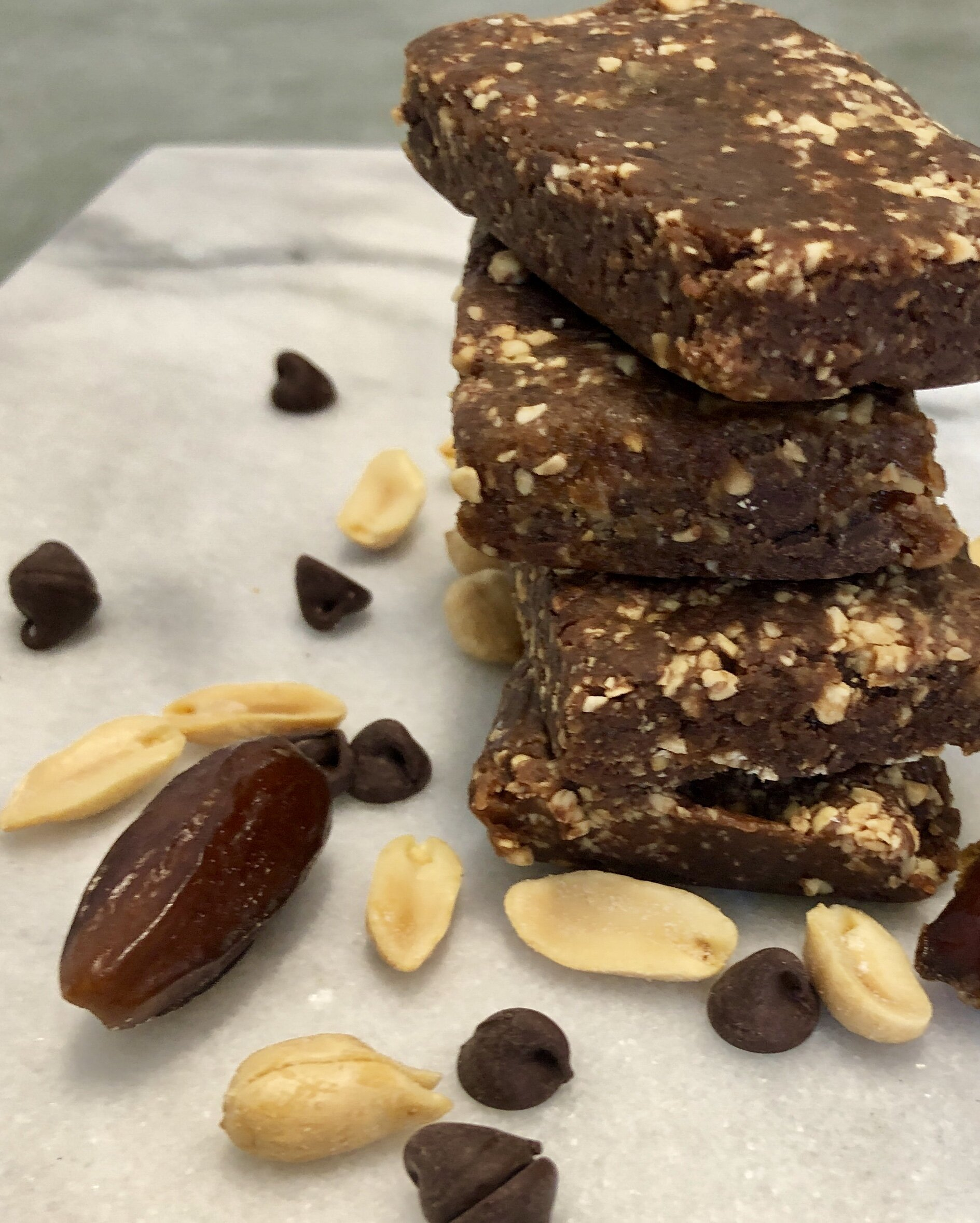 Homemade Chocolate Peanut Energy Bars - 4 simple ingredients and 10 minutes is all you need to replicate this popular LaraBar flavor.